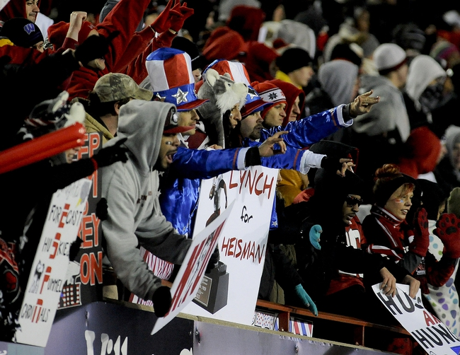 Nov 13, 2013; DeKalb, IL, USA;  Fans cheer as Northern Illinois Cardinals quarterback Jordan Lynch (not pictured) scored a touchdown in the 4th quarter against Ball State Huskies at Huskie Stadium. Mandatory Credit: Matt Marton-USA TODAY Sports