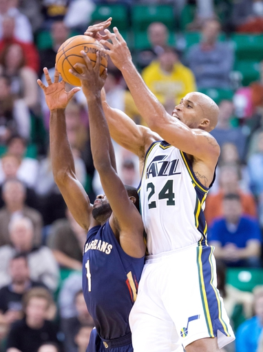 Nov 13, 2013; Salt Lake City, UT, USA; Utah Jazz small forward Richard Jefferson (24) battles for a rebound with New Orleans Pelicans point guard Tyreke Evans (1) during the second half at EnergySolutions Arena. The Jazz won 111-105. Mandatory Credit: Russ Isabella-USA TODAY Sports