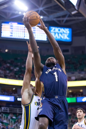 Nov 13, 2013; Salt Lake City, UT, USA; New Orleans Pelicans point guard Tyreke Evans (1) goes up for a shot during the second half against the Utah Jazz at EnergySolutions Arena. The Jazz won 111-105. Mandatory Credit: Russ Isabella-USA TODAY Sports