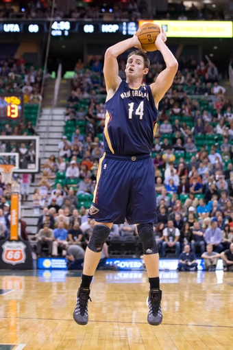 Nov 13, 2013; Salt Lake City, UT, USA; New Orleans Pelicans center Jason Smith (14) controls the ball during the second half against the Utah Jazz at EnergySolutions Arena. The Jazz won 111-105. Mandatory Credit: Russ Isabella-USA TODAY Sports