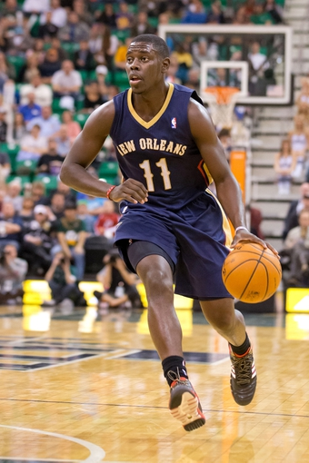 Nov 13, 2013; Salt Lake City, UT, USA; New Orleans Pelicans point guard Jrue Holiday (11) dribbles up the court during the second half against the Utah Jazz at EnergySolutions Arena. The Jazz won 111-105. Mandatory Credit: Russ Isabella-USA TODAY Sports