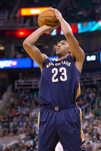 Nov 13, 2013; Salt Lake City, UT, USA; New Orleans Pelicans power forward Anthony Davis (23) shoots during the second half against the Utah Jazz at EnergySolutions Arena. The Jazz won 111-105. Mandatory Credit: Russ Isabella-USA TODAY Sports
