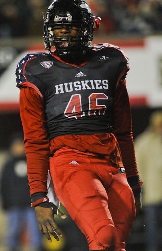 Nov 13, 2013; DeKalb, IL, USA;  Northern Illinois Cardinals defensive end George Rainey (46) celebrates after he stopped Ball State Huskies half back Jahwan Edwards (not pictured) in the 4th quarter at Huskie Stadium. Mandatory Credit: Matt Marton-USA TODAY Sports