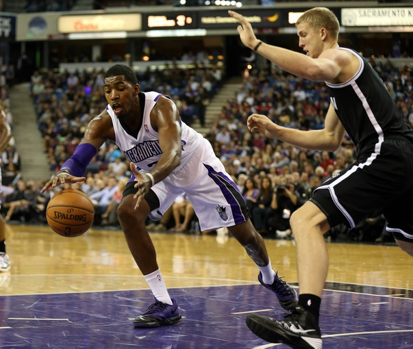 Nov 13, 2013; Sacramento, CA, USA; Sacramento Kings power forward Jason Thompson (34) pulls in the ball against Brooklyn Nets power forward Mason Plumlee (1) during the third quarter at Sleep Train Arena. The Sacramento Kings defeated the Brooklyn Nets 107-86. Mandatory Credit: Kelley L Cox-USA TODAY Sports