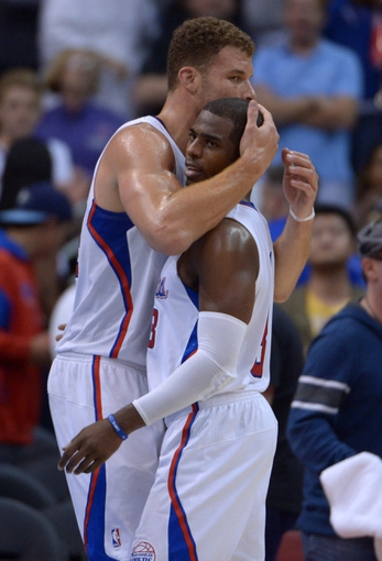 Nov 13, 2013; Los Angeles, CA, USA; Los Angeles Clippers forward Blake Griffin (32) and guard Chris Paul (3) embrace at the end of the game against the Oklahoma City Thunder at Staples Center. The Clippers defeated the Thunder 111-103. Mandatory Credit: Kirby Lee-USA TODAY Sports