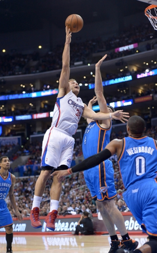 Nov 13, 2013; Los Angeles, CA, USA; Los Angeles Clippers forward Blake Griffin (32) is defended by Oklahoma City Thunder forward Nick Collison (4) at Staples Center. The Clippers defeated the Thunder 111-103. Mandatory Credit: Kirby Lee-USA TODAY Sports