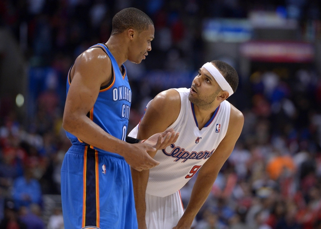 Nov 13, 2013; Los Angeles, CA, USA; Oklahoma City Thunder guard Russell Westbrook (0) and Los Angeles Clippers forward Jared Dudley (9) during the game at Staples Center. The Clippers defeated the Thunder 111-103. Mandatory Credit: Kirby Lee-USA TODAY Sports