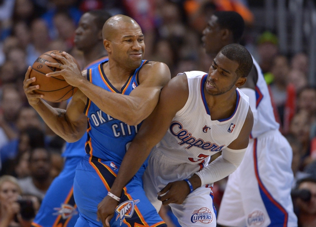 Nov 13, 2013; Los Angeles, CA, USA; Oklahoma City Thunder guard Derek Fisher (2) is defended by Los Angeles Clippers guard Chris Paul (3) at Staples Center. The Clippers defeated the Thunder 111-103. Mandatory Credit: Kirby Lee-USA TODAY Sports