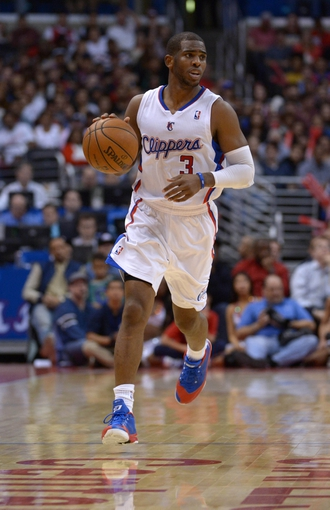 Nov 13, 2013; Los Angeles, CA, USA; Los Angeles Clippers guard Chris Paul (3) dribbles the ball against the Oklahoma City Thunder at Staples Center. The Clippers defeated the Thunder 111-103. Mandatory Credit: Kirby Lee-USA TODAY Sports