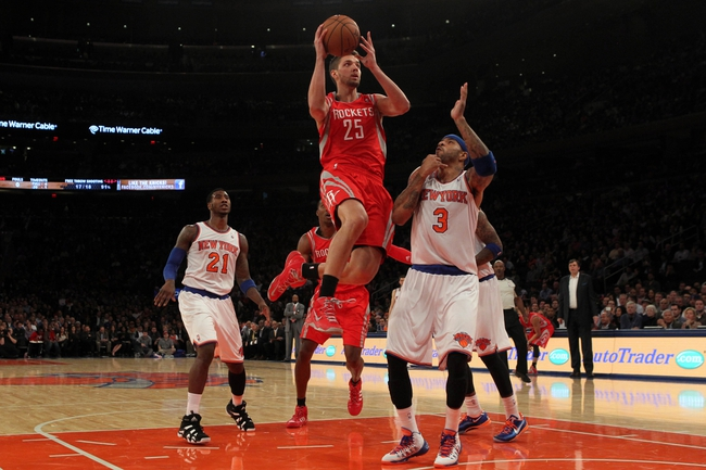 Nov 14, 2013; New York, NY, USA; Houston Rockets small forward Chandler Parsons (25) drives to the basket on New York Knicks power forward Kenyon Martin (3) during the second quarter of a game at Madison Square Garden. Mandatory Credit: Brad Penner-USA TODAY Sports