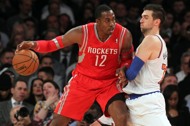 Nov 14, 2013; New York, NY, USA; Houston Rockets power forward Dwight Howard (12) controls the ball against New York Knicks power forward Andrea Bargnani (77) during the third quarter of a game at Madison Square Garden. The Rockets beat the Knicks 109-106. Mandatory Credit: Brad Penner-USA TODAY Sports