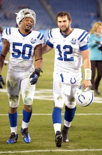Nov 14, 2013; Nashville, TN, USA; Indianapolis Colts quarterback Andrew Luck (12) and linebacker Jerrell Freeman (50) react after the game against the Tennessee Titans. The Colts defeated the Titans 30-27. Mandatory Credit: Kirby Lee-USA TODAY Sports