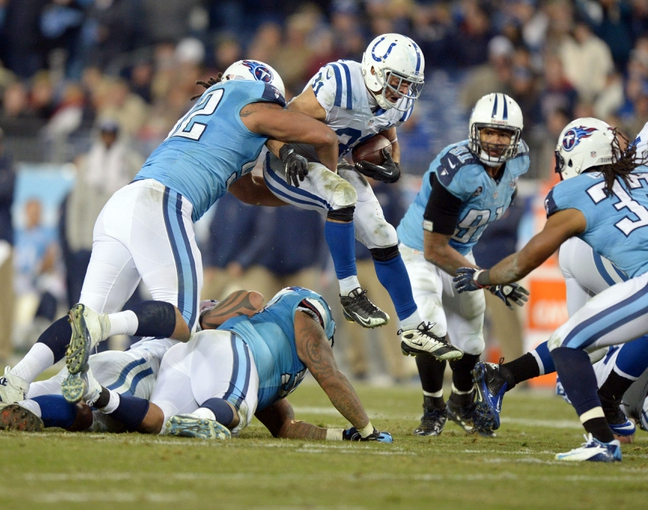 Nov 14, 2013; Nashville, TN, USA; Tennessee Titans defensive end Ropati Pitoitua (92) tackles Indianapolis Colts running back Donald Brown (31) in the fourth quarter at LP Field. The Colts defeated the Titans 30-27. Mandatory Credit: Kirby Lee-USA TODAY Sports