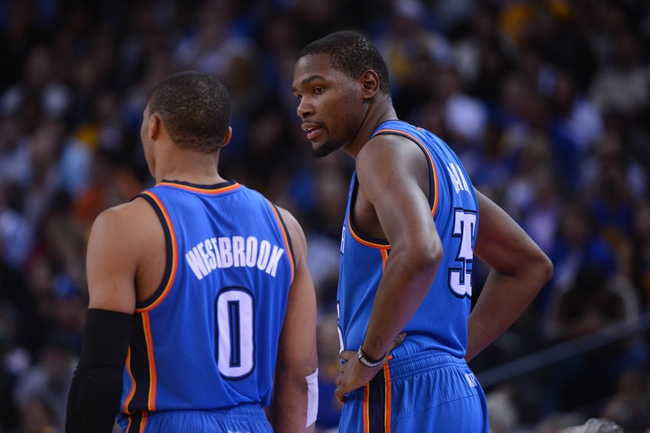 November 14, 2013; Oakland, CA, USA; Oklahoma City Thunder small forward Kevin Durant (35, right) talks to point guard Russell Westbrook (0) against the Golden State Warriors during the third quarter at Oracle Arena. The Warriors defeated the Thunder 116-115. Mandatory Credit: Kyle Terada-USA TODAY Sports