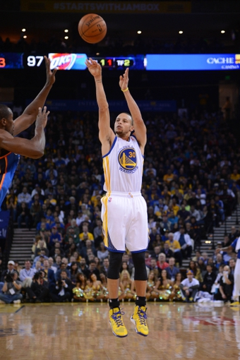 November 14, 2013; Oakland, CA, USA; Golden State Warriors point guard Stephen Curry (30) shoots the ball against Oklahoma City Thunder during the fourth quarter at Oracle Arena. The Warriors defeated the Thunder 116-115. Mandatory Credit: Kyle Terada-USA TODAY Sports