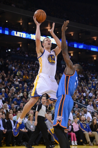 November 14, 2013; Oakland, CA, USA; Golden State Warriors power forward David Lee (10) shoots the ball against Oklahoma City Thunder power forward Serge Ibaka (9) during the third quarter at Oracle Arena. The Warriors defeated the Thunder 116-115. Mandatory Credit: Kyle Terada-USA TODAY Sports
