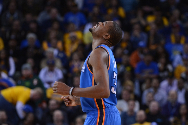 November 14, 2013; Oakland, CA, USA; Oklahoma City Thunder small forward Kevin Durant (35) reacts after missing a basket against the Golden State Warriors during the third quarter at Oracle Arena. The Warriors defeated the Thunder 116-115. Mandatory Credit: Kyle Terada-USA TODAY Sports