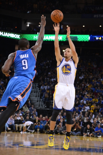 November 14, 2013; Oakland, CA, USA; Golden State Warriors point guard Stephen Curry (30) shoots the ball against Oklahoma City Thunder power forward Serge Ibaka (9) during the fourth quarter at Oracle Arena. The Warriors defeated the Thunder 116-115. Mandatory Credit: Kyle Terada-USA TODAY Sports