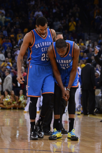 November 14, 2013; Oakland, CA, USA; Oklahoma City Thunder shooting guard Thabo Sefolosha (25) consoles small forward Kevin Durant (35) during the fourth quarter against the Golden State Warriors at Oracle Arena. The Warriors defeated the Thunder 116-115. Mandatory Credit: Kyle Terada-USA TODAY Sports