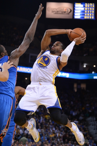 November 14, 2013; Oakland, CA, USA; Golden State Warriors small forward Andre Iguodala (9) shoots the ball against the Oklahoma City Thunder during the fourth quarter at Oracle Arena. The Warriors defeated the Thunder 116-115. Mandatory Credit: Kyle Terada-USA TODAY Sports