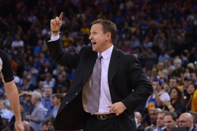 November 14, 2013; Oakland, CA, USA; Oklahoma City Thunder head coach Scott Brooks instructs during the fourth quarter against the Golden State Warriors at Oracle Arena. The Warriors defeated the Thunder 116-115. Mandatory Credit: Kyle Terada-USA TODAY Sports