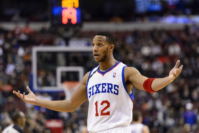 Nov 13, 2013; Philadelphia, PA, USA; Philadelphia 76ers guard Evan Turner (12) during overtime against the Houston Rockets at Wells Fargo Center. The Sixers defeated the Rockets 123-117. Mandatory Credit: Howard Smith-USA TODAY Sports