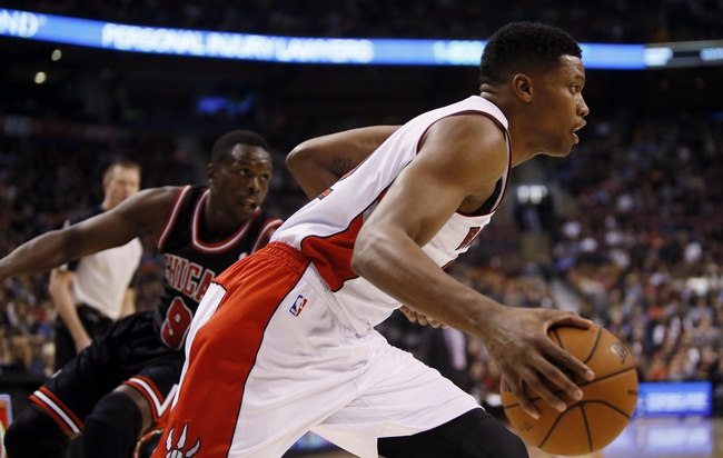 Nov 15, 2013; Toronto, Ontario, CAN; Toronto Raptors forward Rudy Gay (22) carries the ball past Chicago Bulls forward Luol Deng (9) during the first half at the Air Canada Centre. Mandatory Credit: John E. Sokolowski-USA TODAY Sports
