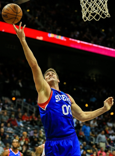 Nov 15, 2013; Atlanta, GA, USA; Philadelphia 76ers center Spencer Hawes (00) reaches for a pass in the first quarter against the Atlanta Hawks at Philips Arena. Mandatory Credit: Daniel Shirey-USA TODAY Sports