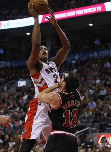 Nov 15, 2013; Toronto, Ontario, CAN; Toronto Raptors forward Rudy Gay (22) goes to shoot has Chicago Bulls guard Kirk Hinrich (12) defends during the first half at the Air Canada Centre. Mandatory Credit: John E. Sokolowski-USA TODAY Sports