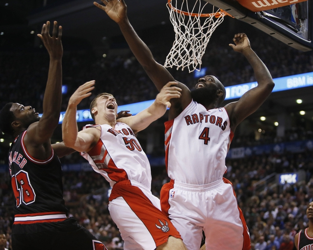 Nov 15, 2013; Toronto, Ontario, CAN; Chicago Bulls center Nazr Mohammed (48) and Toronto Raptors forward Tyler Hansbrough (50) and forward Quincy Acy (4) go after a rebound during the first half at the Air Canada Centre. Mandatory Credit: John E. Sokolowski-USA TODAY Sports