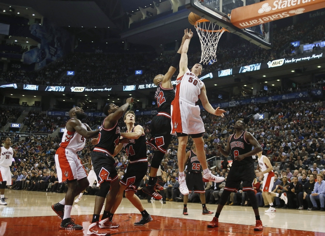 Nov 15, 2013; Toronto, Ontario, CAN; Toronto Raptors forward Tyler Hansbrough (50) and Chicago Bulls forward-center Taj Gibson (22) battle for a ball as Toronto Raptors forward Quincy Acy (4) and Chicago Bulls center Nazr Mohammed (48) and forward Mike Dunleavy (34) and forward Luol Deng (9) look on during the first half at the Air Canada Centre. Mandatory Credit: John E. Sokolowski-USA TODAY Sports