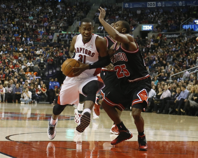 Nov 15, 2013; Toronto, Ontario, CAN; Toronto Raptors guard Terrence Ross (31) tries to get by Chicago Bulls guard Marquis Teague (25) during the first half at the Air Canada Centre. Mandatory Credit: John E. Sokolowski-USA TODAY Sports