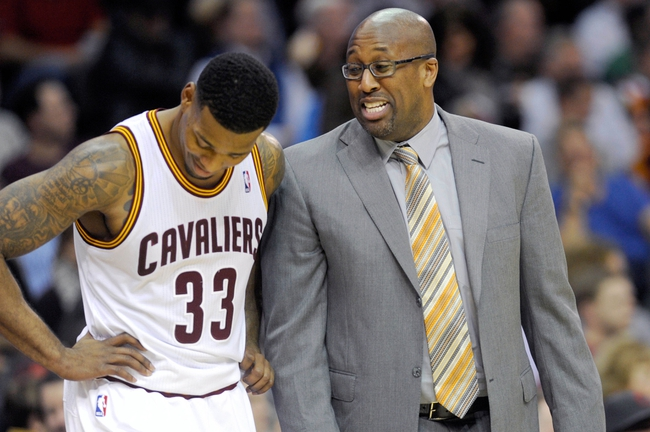 Nov 15, 2013; Cleveland, OH, USA; Cleveland Cavaliers head coach Mike Brown talks with small forward Alonzo Gee (33) during the second quarter against the Charlotte Bobcats  at Quicken Loans Arena. Mandatory Credit: Ken Blaze-USA TODAY Sports