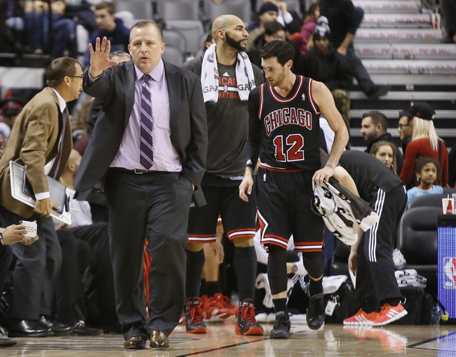 Nov 15, 2013; Toronto, Ontario, CAN; Chicago Bulls head coach Tom Thibodeau gestures to the Toronto Raptors bench at the end of the game at the Air Canada Centre. Chicago defeated Toronto 96-80. Mandatory Credit: John E. Sokolowski-USA TODAY Sports