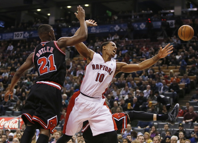 Nov 15, 2013; Toronto, Ontario, CAN; Chicago Bulls guard-forward Jimmy Butler (21) defends against Toronto Raptors guard DeMar DeRozan (10) during the first half at the Air Canada Centre. Mandatory Credit: John E. Sokolowski-USA TODAY Sports