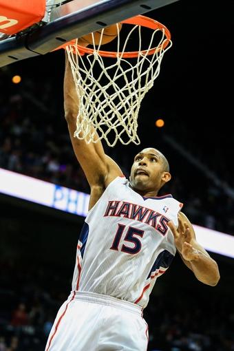Nov 15, 2013; Atlanta, GA, USA; Atlanta Hawks center Al Horford (15) dunks in the second half against the Philadelphia 76ers at Philips Arena. The Hawks won 113-103. Mandatory Credit: Daniel Shirey-USA TODAY Sports