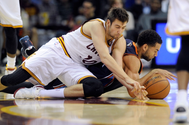 Nov 15, 2013; Cleveland, OH, USA; Cleveland Cavaliers shooting guard Sergey Karasev (10) and Charlotte Bobcats shooting guard Jeff Taylor (44) fight for a loose ball during the third quarter at Quicken Loans Arena. The Bobcats beat the Cavaliers 86-80. Mandatory Credit: Ken Blaze-USA TODAY Sports