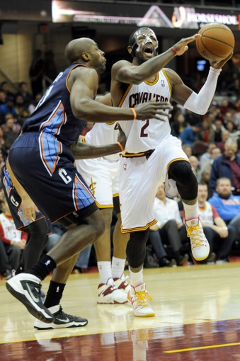 Nov 15, 2013; Cleveland, OH, USA; Cleveland Cavaliers point guard Kyrie Irving (2) drives on Charlotte Bobcats power forward Anthony Tolliver (43) during the fourth quarter at Quicken Loans Arena. The Bobcats beat the Cavaliers 86-80. Mandatory Credit: Ken Blaze-USA TODAY Sports