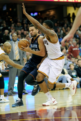 Nov 15, 2013; Cleveland, OH, USA; Charlotte Bobcats shooting guard Jeff Taylor (44) drives on Cleveland Cavaliers small forward Alonzo Gee (33) during the third quarter at Quicken Loans Arena. The Bobcats beat the Cavaliers 86-80. Mandatory Credit: Ken Blaze-USA TODAY Sports
