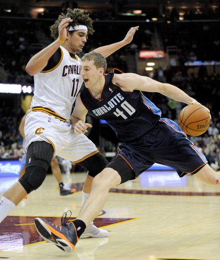 Nov 15, 2013; Cleveland, OH, USA; Charlotte Bobcats center Cody Zeller (40) drives on Cleveland Cavaliers center Anderson Varejao (17) during the third quarter at Quicken Loans Arena. The Bobcats beat the Cavaliers 86-80. Mandatory Credit: Ken Blaze-USA TODAY Sports