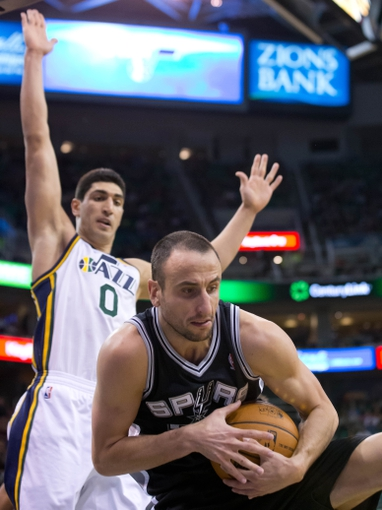 Nov 15, 2013; Salt Lake City, UT, USA; San Antonio Spurs shooting guard Manu Ginobili (20) grabs a rebound in front of Utah Jazz center Enes Kanter (0) during the second half at EnergySolutions Arena. San Antonio won 91-82. Mandatory Credit: Russ Isabella-USA TODAY Sports