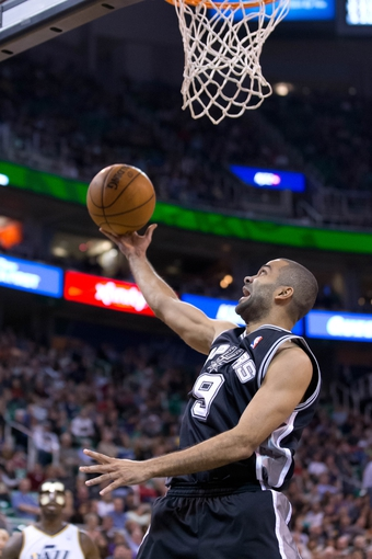 Nov 15, 2013; Salt Lake City, UT, USA; San Antonio Spurs point guard Tony Parker (9) shoots during the second half against the Utah Jazz at EnergySolutions Arena. San Antonio won 91-82. Mandatory Credit: Russ Isabella-USA TODAY Sports