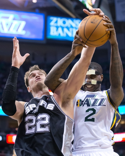 Nov 15, 2013; Salt Lake City, UT, USA; San Antonio Spurs center Tiago Splitter (22) and Utah Jazz power forward Marvin Williams (2) fight for a rebound during the second half at EnergySolutions Arena. San Antonio won 91-82. Mandatory Credit: Russ Isabella-USA TODAY Sports