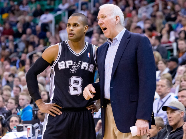 Nov 15, 2013; Salt Lake City, UT, USA; San Antonio Spurs head coach Gregg Popovich talks with point guard Patty Mills (8) during the second half against the Utah Jazz at EnergySolutions Arena. San Antonio won 91-82. Mandatory Credit: Russ Isabella-USA TODAY Sports