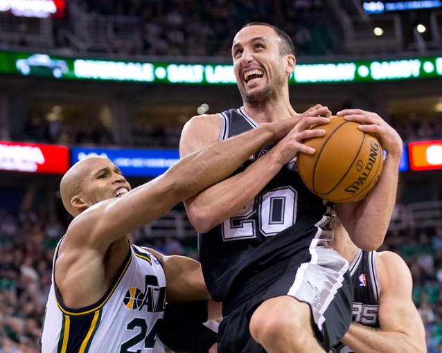 Nov 15, 2013; Salt Lake City, UT, USA; San Antonio Spurs shooting guard Manu Ginobili (20) is fouled by Utah Jazz small forward Richard Jefferson (24) during the second half at EnergySolutions Arena. San Antonio won 91-82. Mandatory Credit: Russ Isabella-USA TODAY Sports