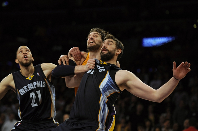 Nov 15, 2013; Los Angeles, CA, USA; Memphis Grizzlies center Marc Gasol (right) and Los Angeles Lakers center Pau Gasol (center) and Memphis Grizzlies forward Tayshaun Prince (center) fight for positioning during the fourth quarter at Staples Center. The Memphis Grizzlies defeated the Los Angeles Lakers 89-86. Mandatory Credit: Kelvin Kuo-USA TODAY Sports