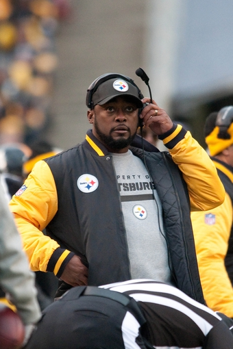 Nov 10, 2013; Pittsburgh, PA, USA; Pittsburgh Steelers head coach Mike Tomlin watches a replay on the scoreboard during the third quarter of a game against the Buffalo Bills at Heinz Field. Pittsburgh won the game 23-10. Mandatory Credit: Mark Konezny-USA TODAY Sports