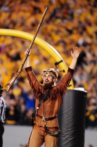 Nov 9, 2013; Morgantown, WV, USA; The West Virginia Mountaineers mascot celebrates during the game against the Texas Longhorns at Milan Puskar Stadium. Mandatory Credit: Evan Habeeb-USA TODAY Sports