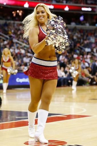 Nov 1, 2013; Washington, DC, USA; A Washington Wizards girl dances on the court against the Philadelphia 76ers at Verizon Center. Mandatory Credit: Geoff Burke-USA TODAY Sports