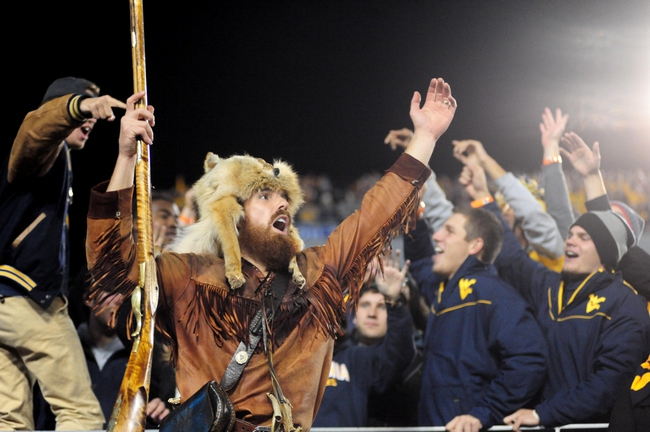 Nov 9, 2013; Morgantown, WV, USA; The West Virginia Mountaineers mascot celebrates with fans during the game against the Texas Longhorns at Milan Puskar Stadium. Mandatory Credit: Evan Habeeb-USA TODAY Sports